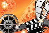 Movie Theater,Film Reel,Film,Film Industry,Movie,Camera Film,Camera - Photographic Equipment,Cinematographer,Orange Color,Performance,Spotlight,Countdown,Symbol,Star Shape,Performing Arts Event,Catwalk - Stage,Motion,Spot Lit,Backgrounds,Cordon Tape,Projection Equipment,Nightlife
