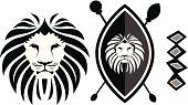Lion - Feline,Africa,Shield,African Culture,Vector,Cartoon,Religious Icon,Black Color,Ilustration,Animal Head,Computer Graphic,Spear,White,Black And White,Front View,Three Objects,Design Element,Isolated,White Background,Wild Animals,Power,Animals And Pets,Concepts And Ideas