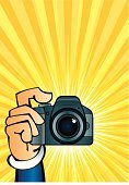Camera - Photographic Equipment,Camera Flash,Cartoon,Flash,Paparazzi Photographer,Human Hand,Holding,Photography Themes,Silhouette,People,Human Arm,Computer Graphic,Yellow,Ilustration,Vector,Drawing - Art Product,Digitally Generated Image,Color Image,Pattern,Projection,Push Button,Pushing,Sunbeam,Aiming,Human Finger,Filming,Image Focus Technique,Design,Equipment,Technology,Vector Backgrounds,Electronics,People,Staring,Shape,Illustrations And Vector Art,Image,Technology,Bright