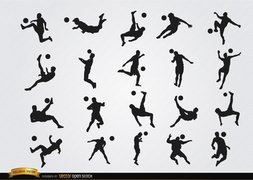 Soccer players' hitting ball jumping silhouettes