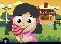 Girl eating ice cream cone in park